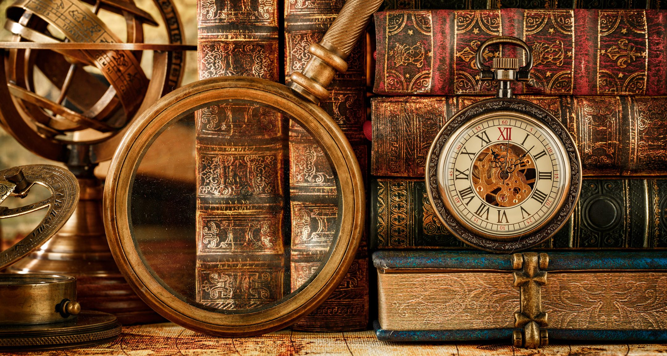 Magnifying glass, pocket watch and old books